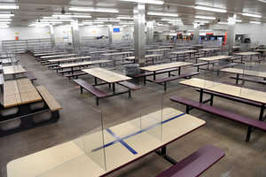 a dock platform: The cafeteria at the JBS beef plant in Greeley, Colo., includes new plexiglass shields at each table. (Andy Cross/MediaNews Group/Denver Post/Getty Images)