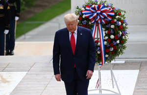President Donald Trump participates in a wreath laying ceremony at the Tomb of the Unknown Soldier at Arlington National Cemetery near Washington in commemoration of the Memorial Day holiday in Arlington, Virginia, U.S., May 25, 2020.