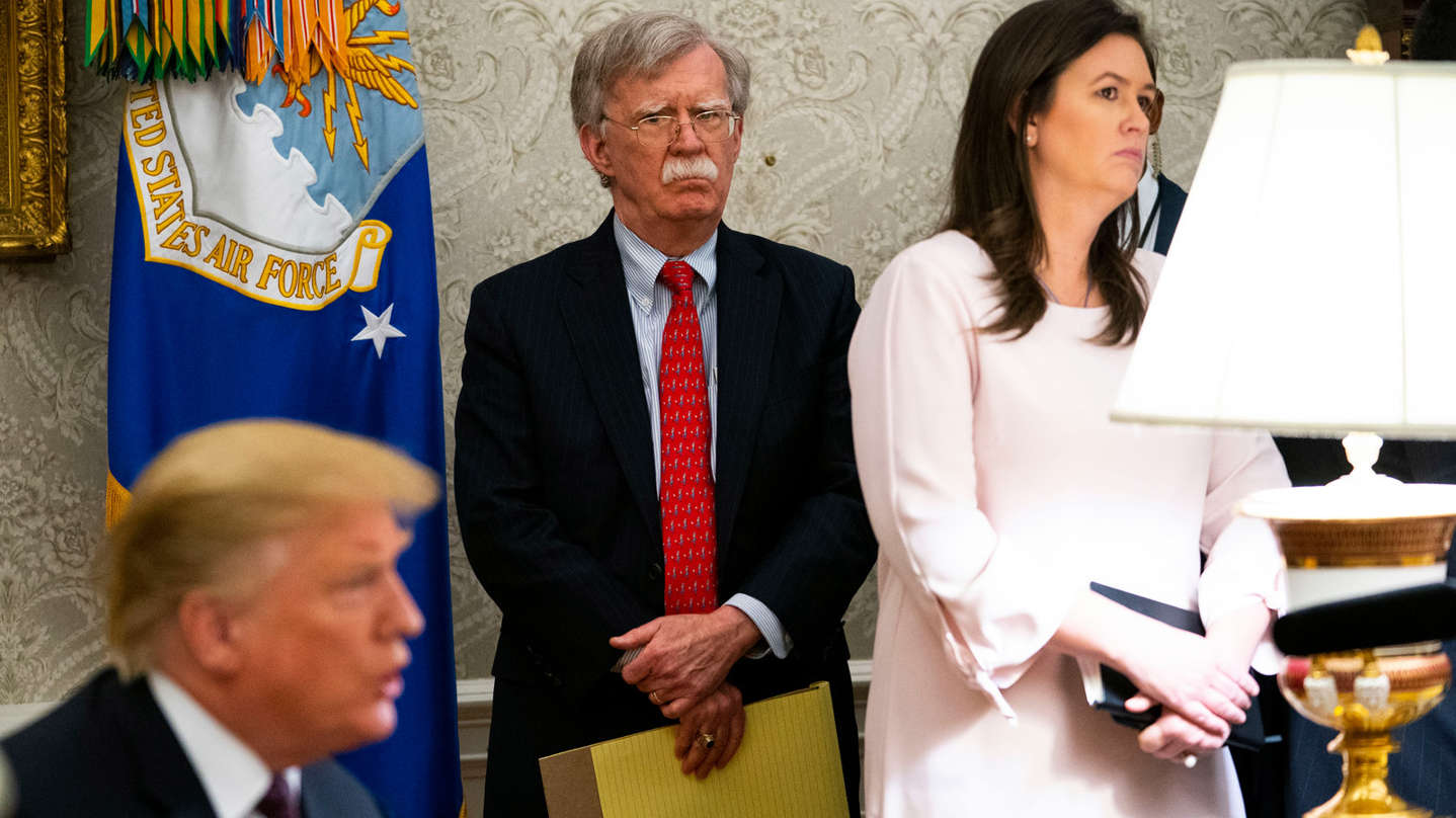 John R. Bolton et al. standing next to a person in a suit and tie: John R. Bolton was President Trump's national security adviser for 17 months. Mr. Trump asked if Finland was part of Russia, Mr. Bolton wrote in his new book.