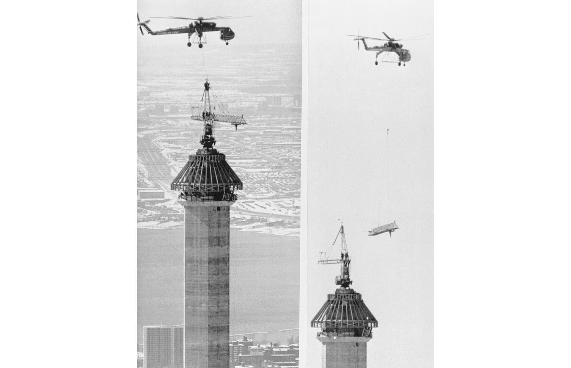 Slide 32 of 41: Construction of this juggernaut involved more than 1,500 workers and the concrete tower is topped out with a 335-foot (102m) antenna. This 1975 photo shows a Sikorsky CH-54 helicopter moving the giant crane used to build the tower, so the antenna could finally be fitted.