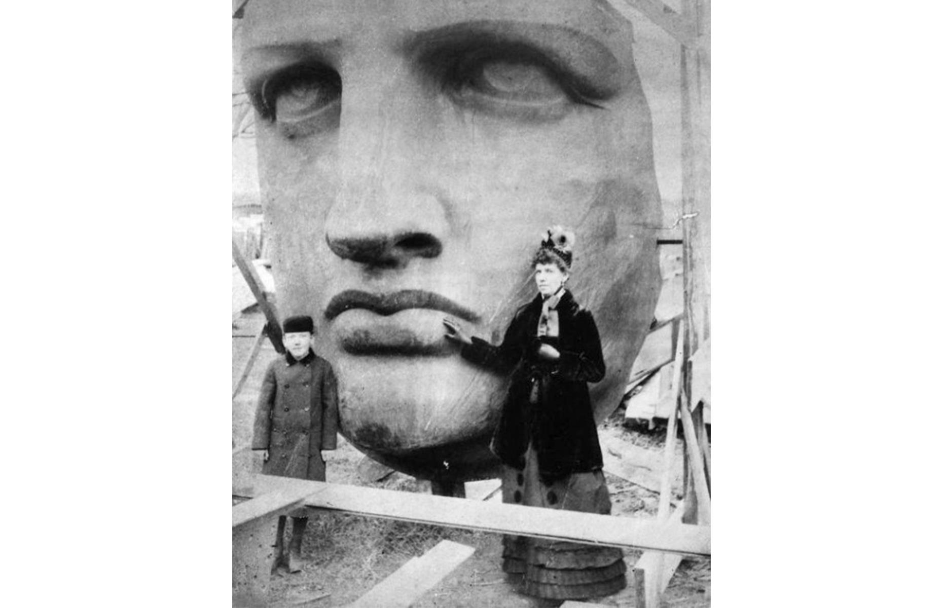 Slide 19 of 41: The official pedestal was designed and built on American soil by architect Richard Morris Hunt, and finished in 1886. Lady Liberty herself arrived at New York Harbor one year before, in 1885, ready to be assembled on her shiny new plinth. Her face is pictured here in June 1885, as she was unpacked from around 214 crates. She was finally dedicated in October 1886. See more vintage images of America's most historic attractions.