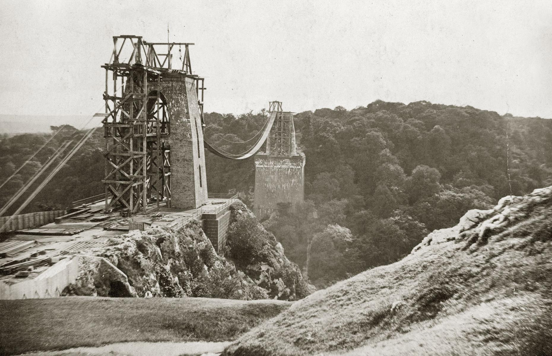 "Slide 38 of 41: Building Bristol's jaw-dropping Clifton Suspension Bridge was no easy feat – in fact, the inscription on the Leigh Woods tower, ""Suspensa Vix Via Fit"" (""a suspended way made with difficulty"") is a reminder of just what a great task it was. It all began in 1753 with merchant William Vick, who bequeathed funds for a bridge spanning the Avon Gorge upon his death. It's seen taking shape more than a century later in this 1863 photograph."