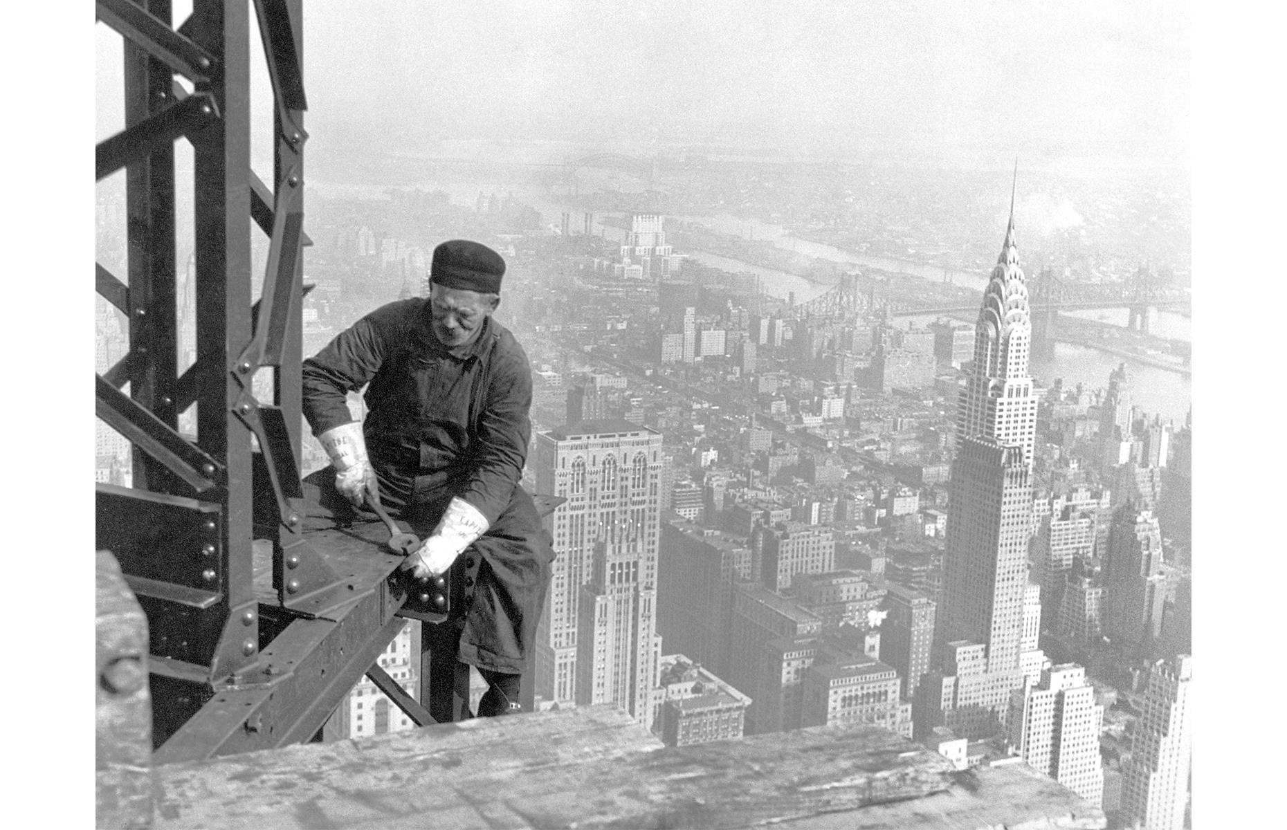 Slide 34 of 41: Held up as an Art Deco icon, New York's Empire State Building (antenna excluded) rises to 1,250 feet (381m) and was the tallest building on the planet upon its completion. Beginning in 1930, its construction involved a whopping 3,000 workers – one of them is pictured bolting metal beams in this 1930 shot.