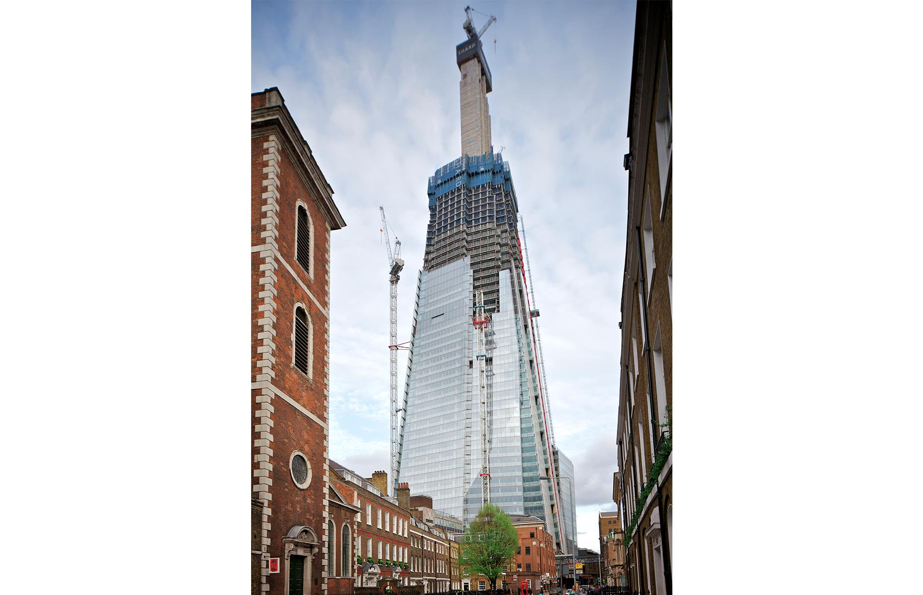 Slide 37 of 41: Still the tallest building in London, The Shard was completed in 2012, and its uber-modern design was the vision of Italian architect Renzo Piano. It took more than 1,450 workers from 60 countries to build this glass behemoth, which rises to 1,004 feet (306m) and has a steel spire weighing 500 tons. It's pictured here as it takes shape in April 2011.