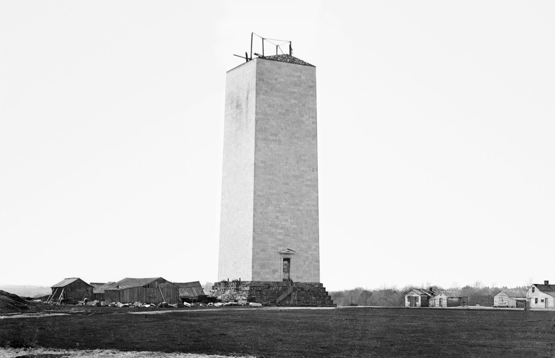 Slide 30 of 41: This enormous marble obelisk soars to 555 feet (169m) and was built as a tribute to first president George Washington. Construction of the monument – which was originally intended to comprise a large pantheon as well as an obelisk – began in 1848, but funds soon dwindled. Work halted and wouldn't begin again until after the Civil War. It recommenced in the 1870s, under the eye of the Ulysses S. Grant, and the landmark was finally dedicated in 1885. It's seen here, partially completed, in the 1860s.
