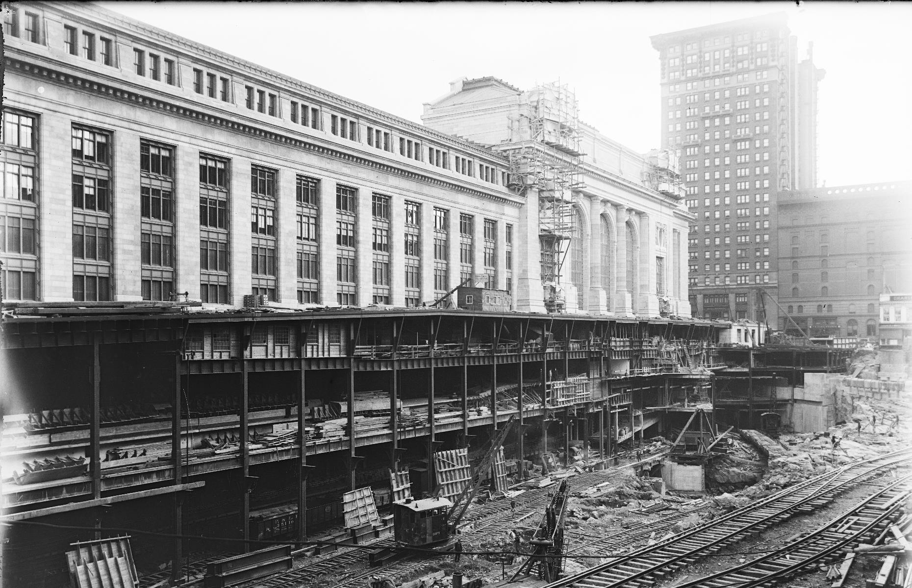 Slide 23 of 41: Construction of the Grand Central Terminal that stands today got underway in 1903 and remains an enduring attraction in New York City.  A replacement for an earlier station, it's celebrated for its Beaux Arts-style architecture, and boasts a façade complete with intricate sculptures, columns and an ornate clock face. It's pictured here, in the throes of construction, around 1912 – it would be finished and opened to the public in 1913.