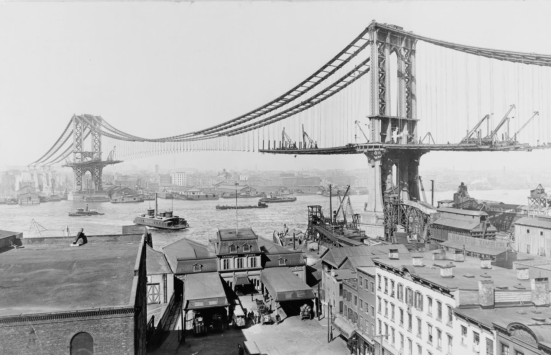 Slide 36 of 41: From one great New York landmark to another: soaring across the East River (and not to be confused with Brooklyn Bridge), this is one of the most striking crossovers in the Big Apple. Work on the suspension bridge began at the turn of the century, and it was opened to traffic in 1909. It's pictured here during the construction of its main span, which would eventually stretch out to 6,855 feet (2,089m). Find the most impressive bridge in your state here.