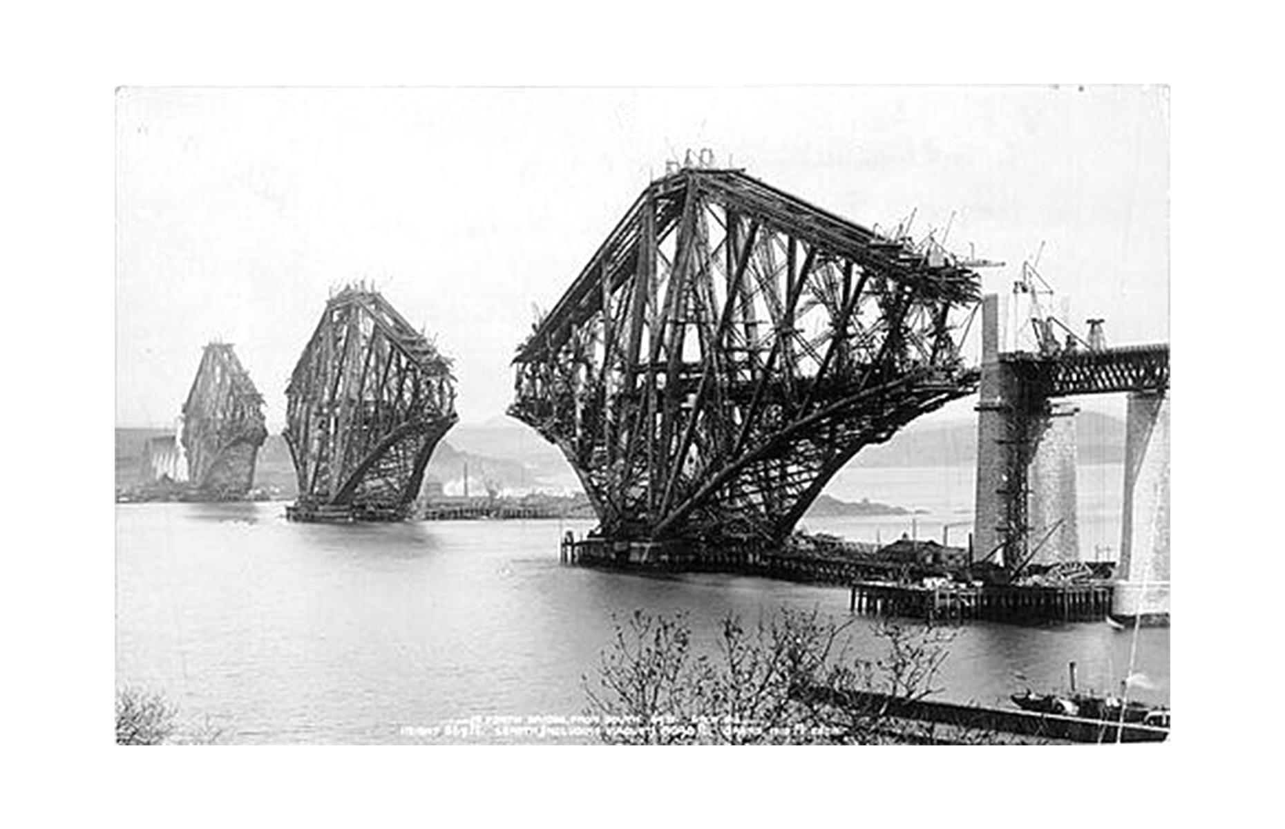 Slide 29 of 41: Some 4,000 workers were employed at the peak of the bridge's construction, and sadly 57 of them lost their lives during the process. The resulting structure, today a UNESCO World Heritage Site, remains a striking tribute to them. It's pictured here circa 1888, a couple of years before its completion.