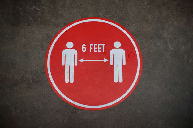 Slide 23 of 50: A decal showing six feet social distancing instructions is seen on the floor of Eastern Market in Washington, Thursday, June 18, 2020. Eastern Market is open for to-go and curbside pickup. (