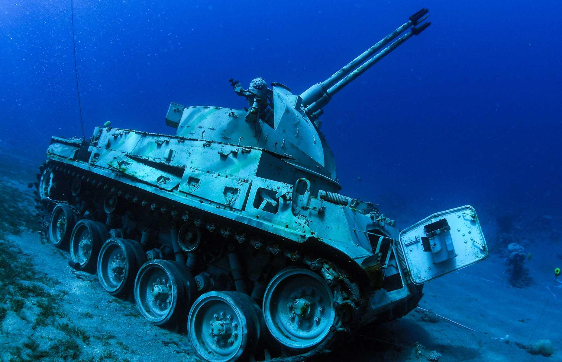 Slide 4 of 31: Just off the coast of Aqaba on Jordan's Red Sea coast is a surprising collection of military hardware. Tanks, a helicopter and a troop carrier have been sunk and arranged to mimic a battle formation. Lying 50 to 90 feet (15-28m) below the surface the museum opened in July 2019 and usually welcomes both divers and snorkelers. Much care was taken not to disturb marine life during the construction, with any hazardous material and chemicals removed.