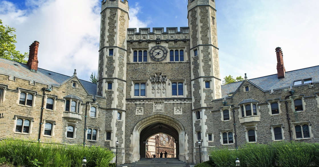 a large stone building with grass in front of a castle: Blair Hall at Princeton University