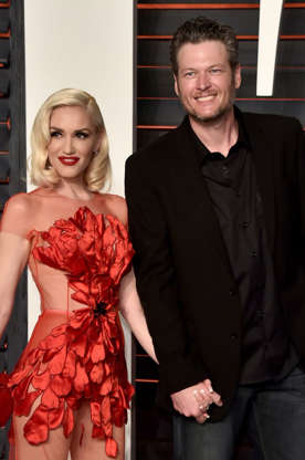 """Slide 13 of 43: Of course, Blake Shelton has also written songs about Gwen Stefani — including this steamy song where he says """"She's Revlon red in the blackest night."""" Gwen is a global ambassador for Revlon and frequently wears red lipstick during public appearances."""