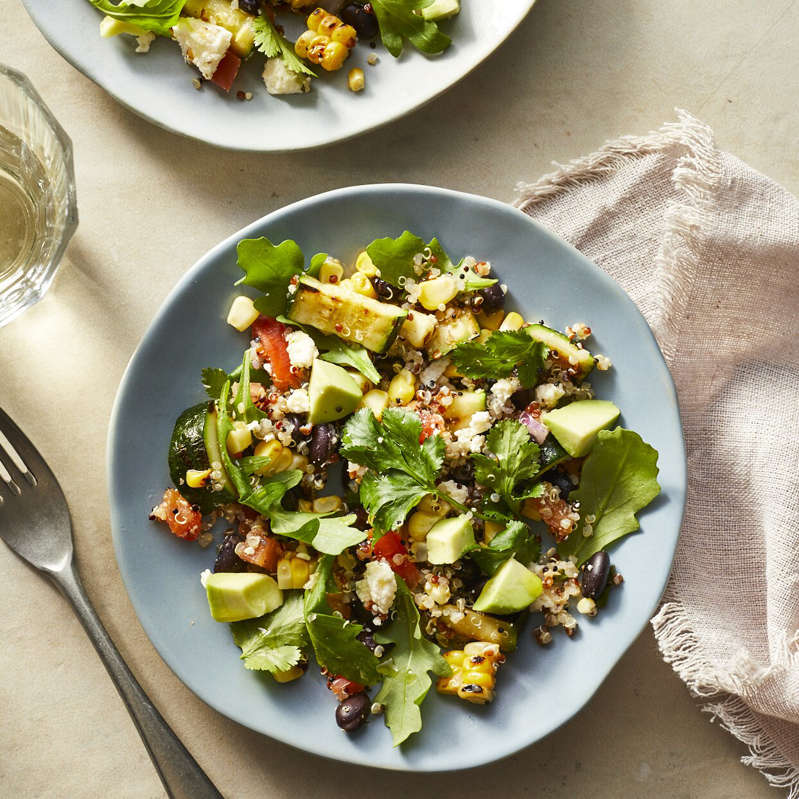 a bowl of food on a plate: Mexican Quinoa Salad