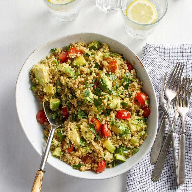 a bowl of food on a plate: Quinoa Avocado Salad