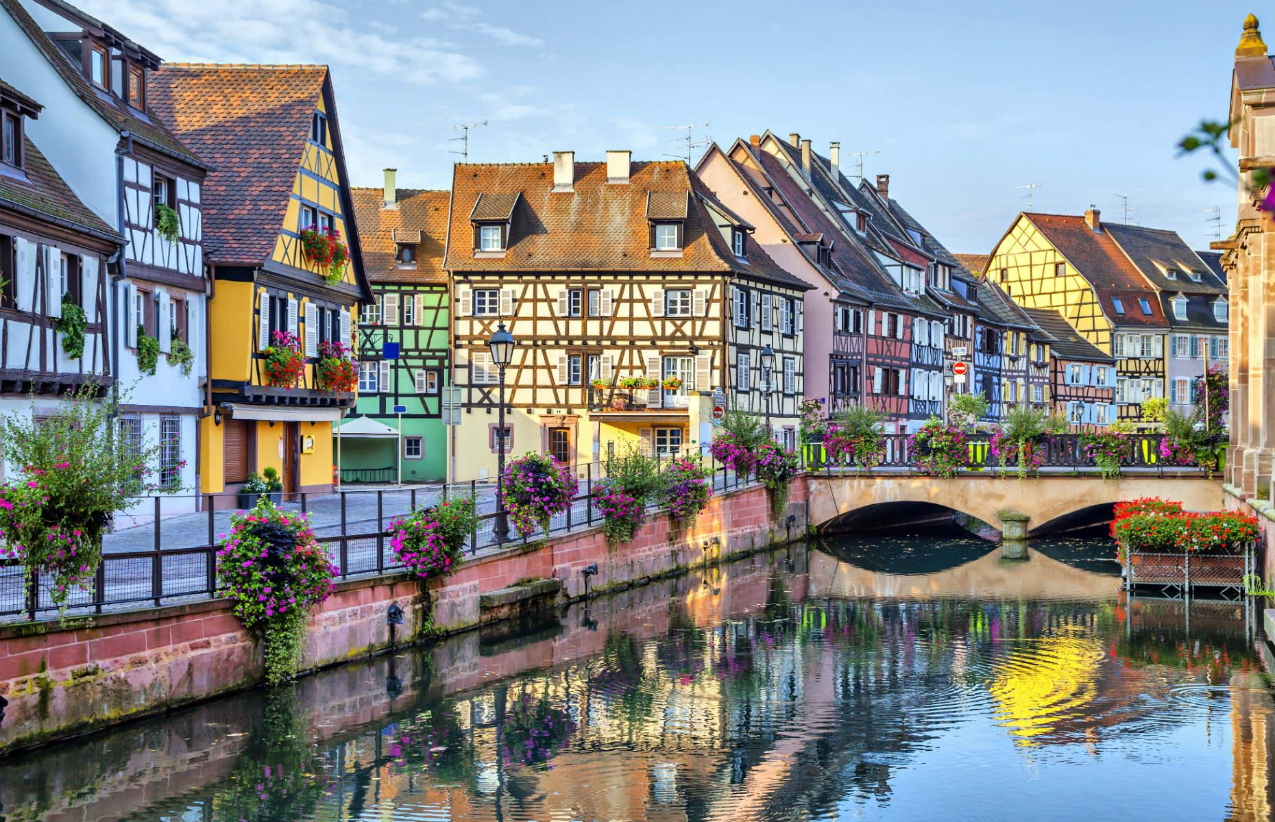 Slide 4 of 51: Winding streets, narrow canals and quaint, pastel-colored houses – Colmar has it all. The pretty town in the Grand Est region of northeastern France is a unique collection of medieval and early Renaissance buildings, including a beautiful 13th-century church. On top of looking every bit like a fairy-tale town, it's also celebrated for being the wine capital of France's Alsace region.