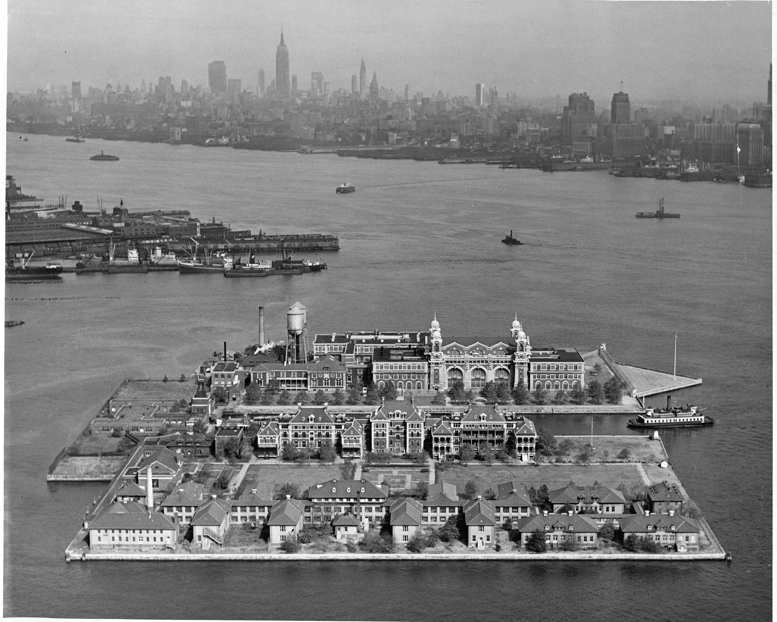 Slide 10 of 31: A 1955 aerial view of Ellis Island may be most astounding due to the much smaller Manhattan skyline, but that's not all worth noting. Over the course of its history, beginning in 1892, around 12 million immigrants passed through this renowned immigration station.