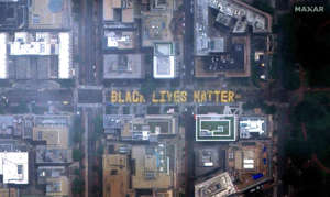 "a store inside of a building: This handout satellite image released by Maxar Technologies shows a giant street lettering of ""Black Lives Matter"" with the flag of Washington, DC at 16th street NW, near the White House, in Washington, DC, on June 6, 2020."