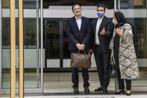 Iranian doctor Majid Taheri (L), who had been detained in the United States for 16 months, is welcomed by his wife and an Iranian Foreign Ministry official upon his arrival at Tehran's Imam Khomeini International Airport on June 8, 2020. - An Iranian scientist returned home after his release from a US jail in what state media said was a prisoner exchange Tehran hopes can be repeated between the arch-foes. He was freed on June 4 as Iran released US Navy veteran Michael White, who had been detained in the Islamic republic since his arrest in July 2018. (Photo by MAJID ASGARIPOUR / MEHR NEWS / AFP) (Photo by MAJID ASGARIPOUR/MEHR NEWS/AFP via Getty Images)