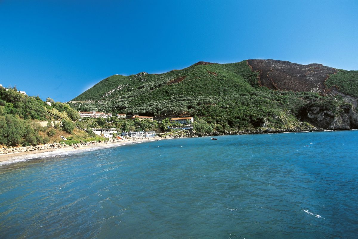 Slide 32 of 41: This island off of Greece's northwest coast has rugged mountains and plenty of resorts along the shore. It also has plenty of history and culture, including medieval lanes, the grand Palace of St. Michael and St. George, and Venetian fortresses to check out.