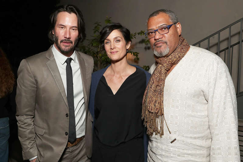 Keanu Reeves, Laurence Fishburne posing for the camera: Todd Williamson/Getty Keanu Reeves, Carrie-Anne Moss and Laurence Fishburne