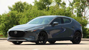 a car parked in a parking lot: 2020 Mazda3: Comparison