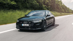 a car driving on a road: 2020 Audi S8 by ABT