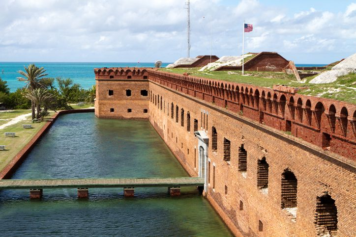 Slide 6 of 22: Travel 70 miles west of Key West and you'll find the Dry Tortugas National Park. Dry Tortugas is a 100-square mile park consisting mostly of water and seven small islands. Even better, it can be accessed only by boat or seaplane.