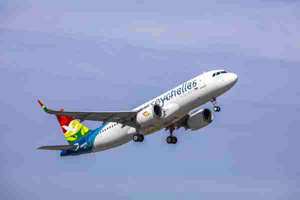 a large air plane flying in the sky: Air Seychelles' first Airbus A320neo. (Photo courtesy of Airbus)