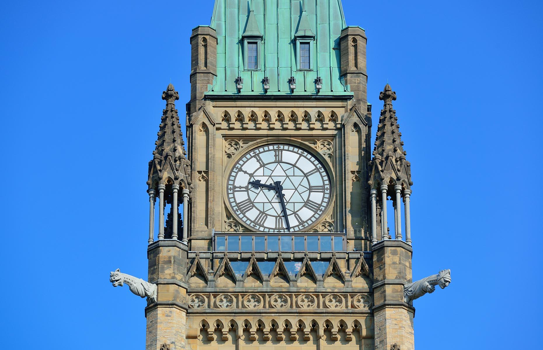 Slide 10 of 41: Located on a grand neo-Gothic building that houses the nation's parliament, this clock also overlooks a popular canal that's filled with boats in summer and ice skaters in winter.