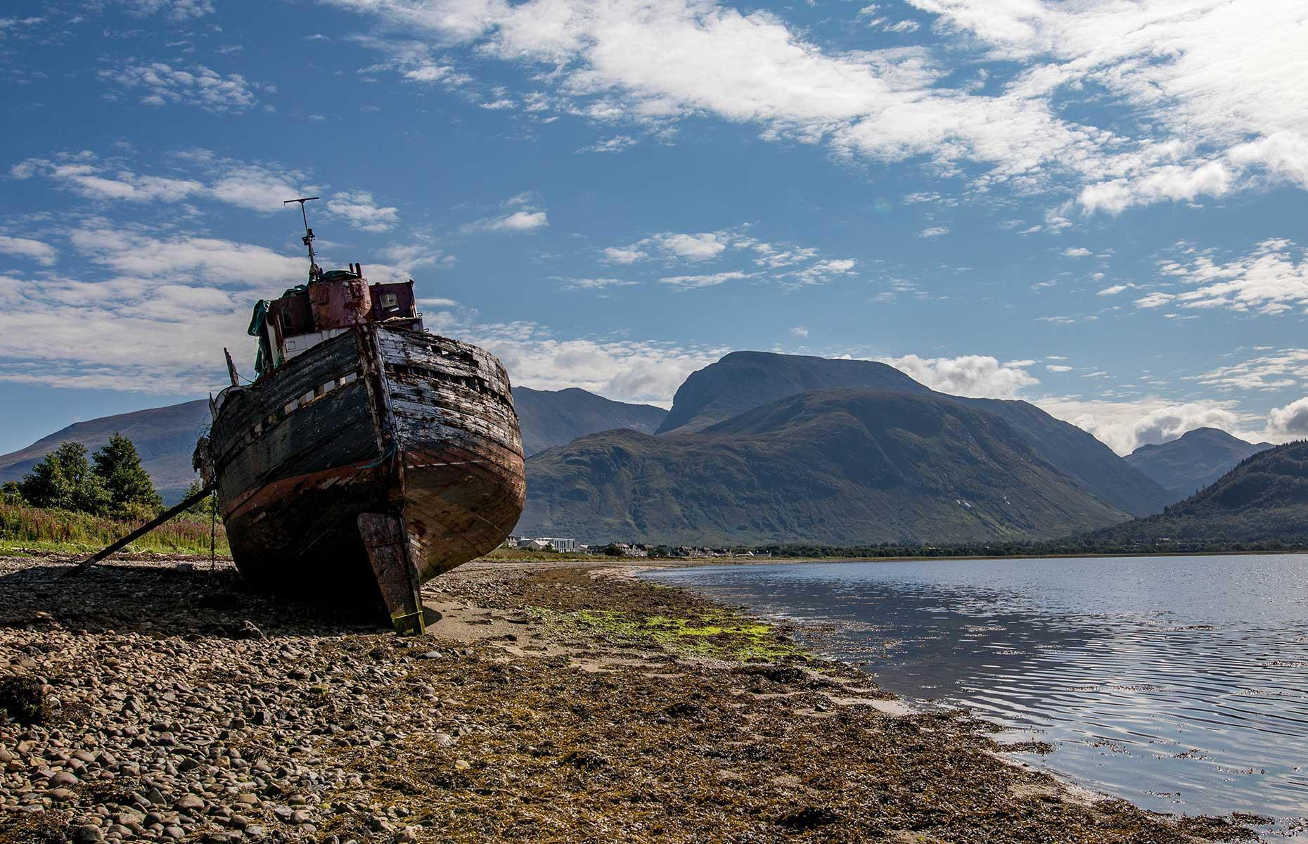 Slide 5 of 35: Today photographers come from around the world to capture what has become known as the Corpach Wreck – it can be pictured with the highest mountain in Britain, Ben Nevis, in the background. Now discover 9 more places you must see in the Scottish Highlands and Islands.