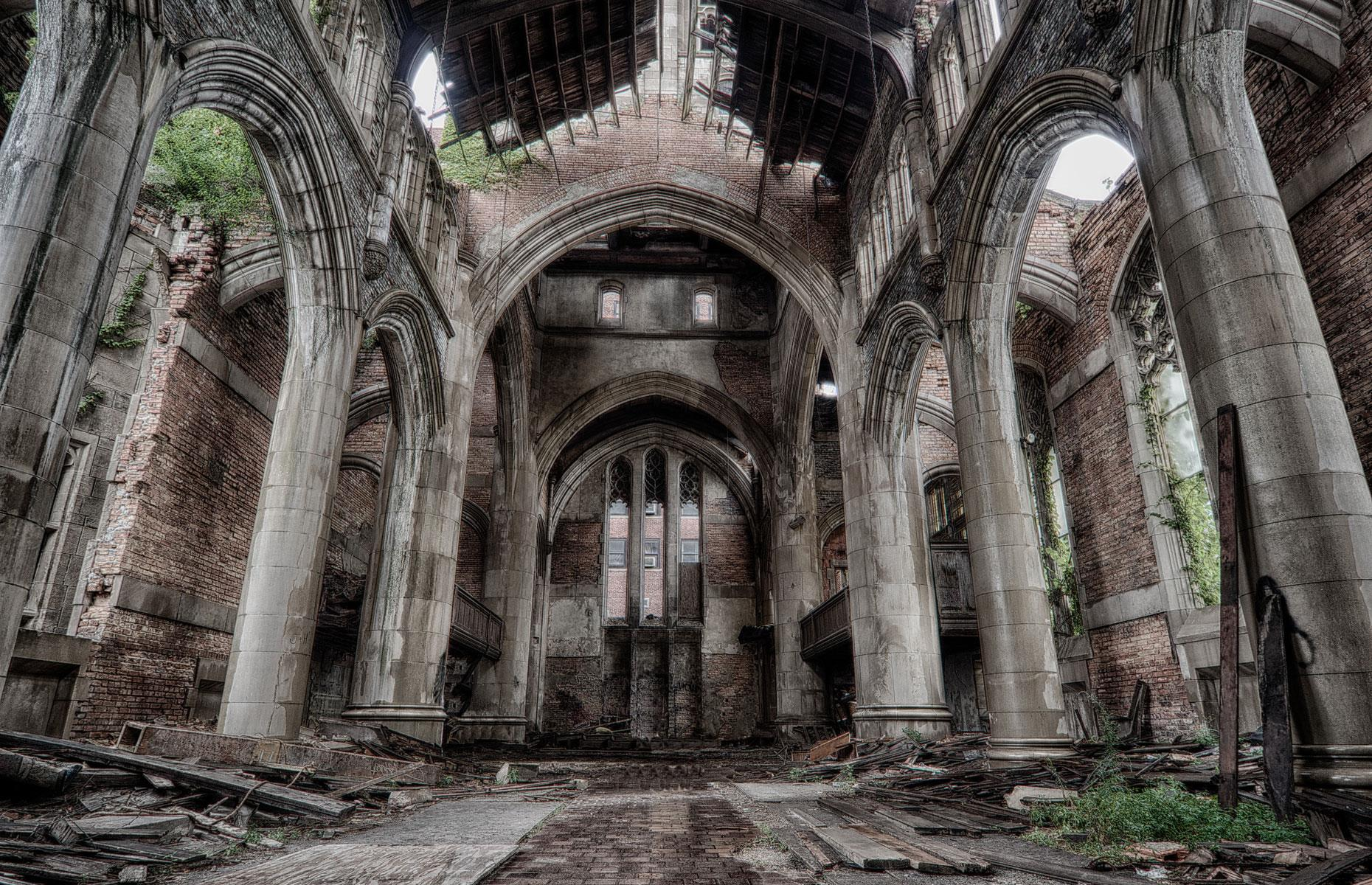 """Slide 29 of 101: By the 1970s, the congregation had dwindled and with those in charge unable to afford the mammoth maintenance costs, the church was forced to shut by 1975. The building sat decaying for decades, but now plans are well underway to turn the site into a """"ruin garden"""" in which the abandoned church's haunting remains will take center stage."""