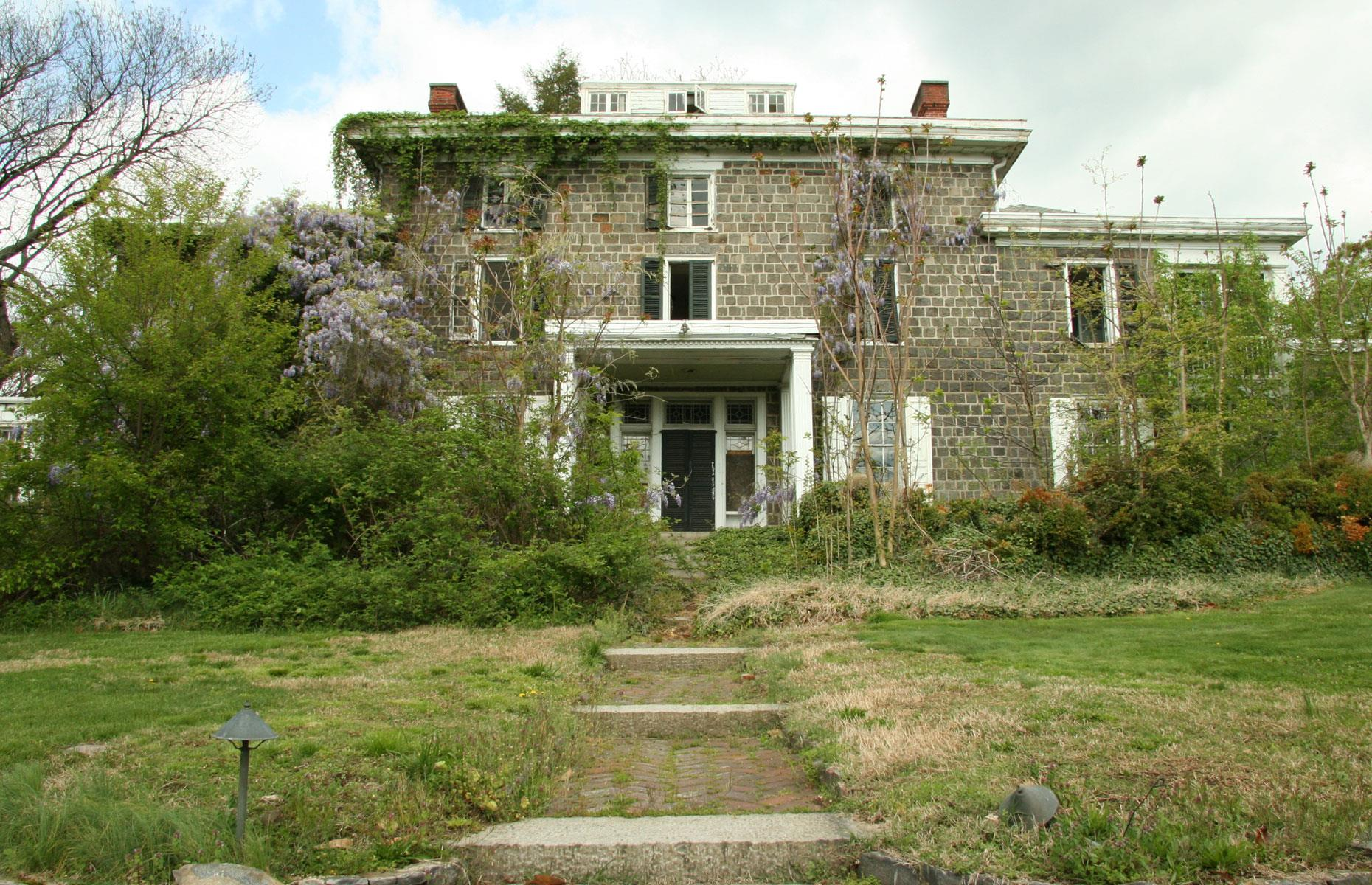 Slide 16 of 101: This country mansion was completed in 1844 for cotton merchant John Rodney Brinckle and was named after the Rock of Gibraltar, a nod to the rugged outcrop on which it was constructed. Abandoned almost three decades ago, the house has fallen into disrepair.