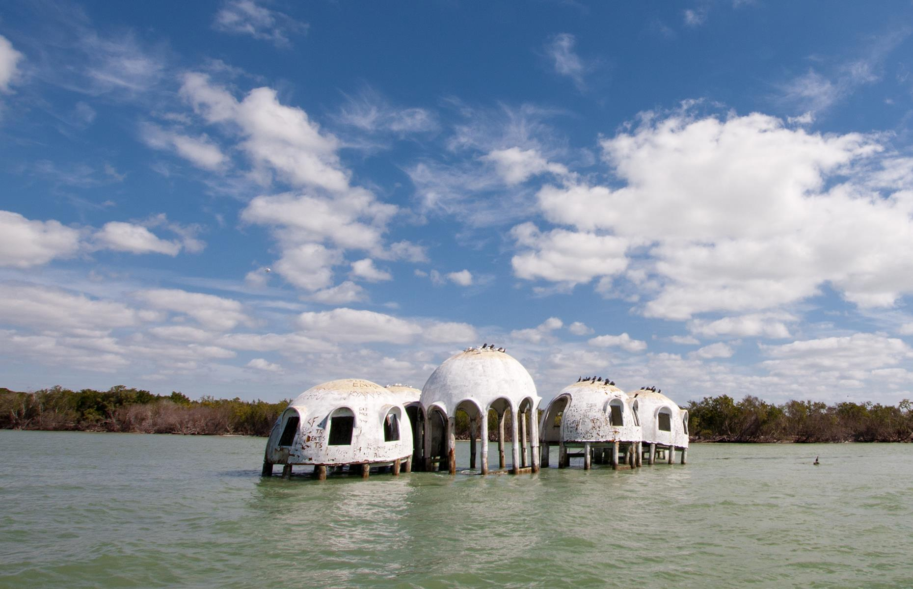 Slide 18 of 101: Looking like the handiwork of extra-terrestrials, this strange dome home was built in the early 1980s on a beach near Cape Romano by retired oil producer Bob Lee. However, Lee was forced to abandon the property in 1992 after Hurricane Andrew rendered it uninhabitable.