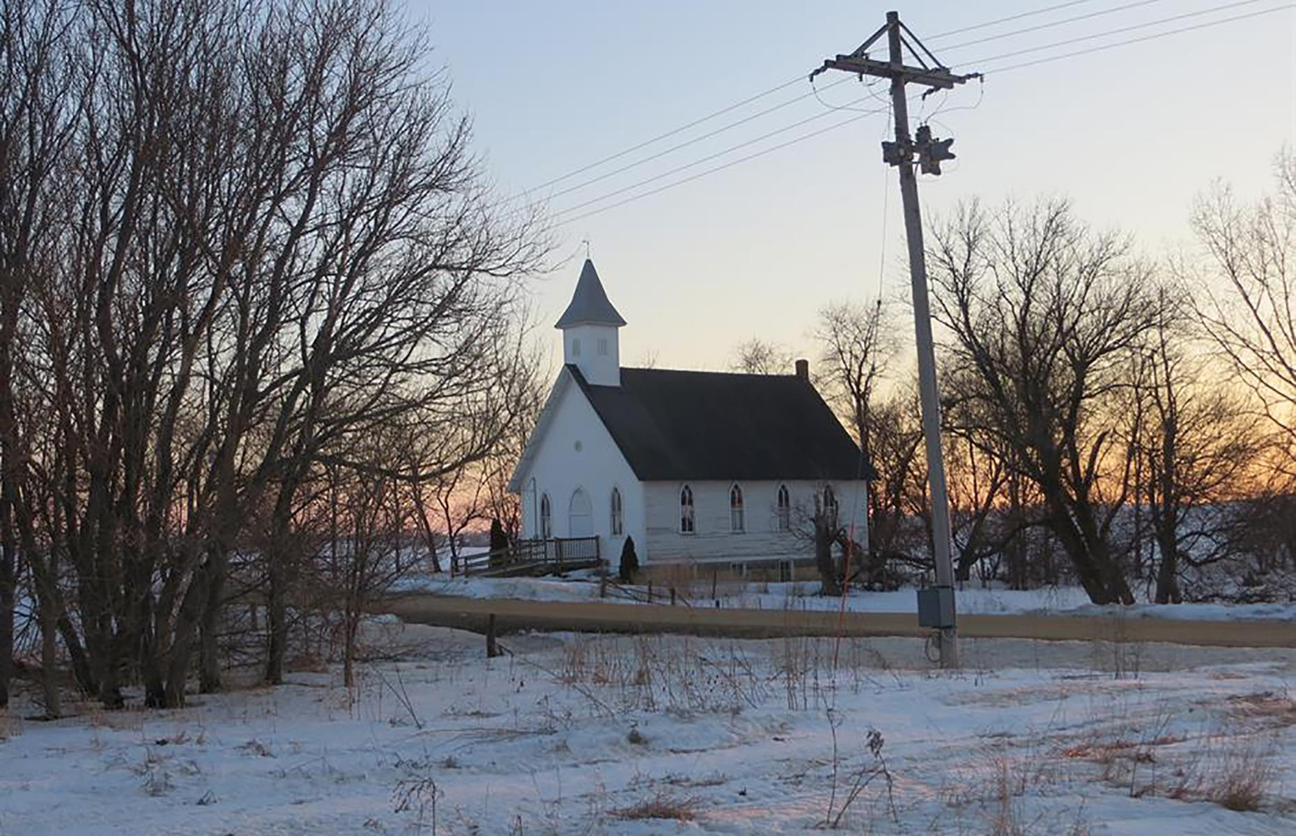 Slide 30 of 101: This little ghost town is tucked away in eastern Iowa, just off busy Highway 64. It's thought that the town leaked residents after much of the property here was bought up by a large commercial dairy in the 1960s.