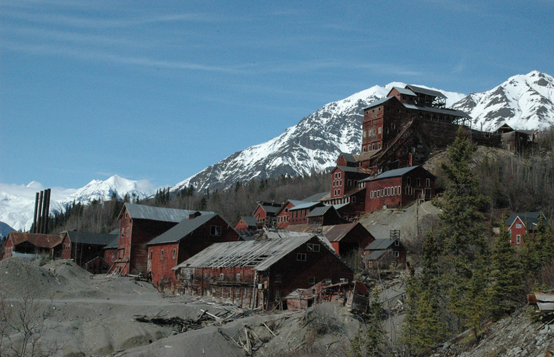 Slide 4 of 101: This imposing mining town in the south of the state was established in 1911. A hive of activity for a time, Kennecott produced millions of dollars' worth of copper ore – but these resources were soon depleted and the mine shut down for good in 1938.