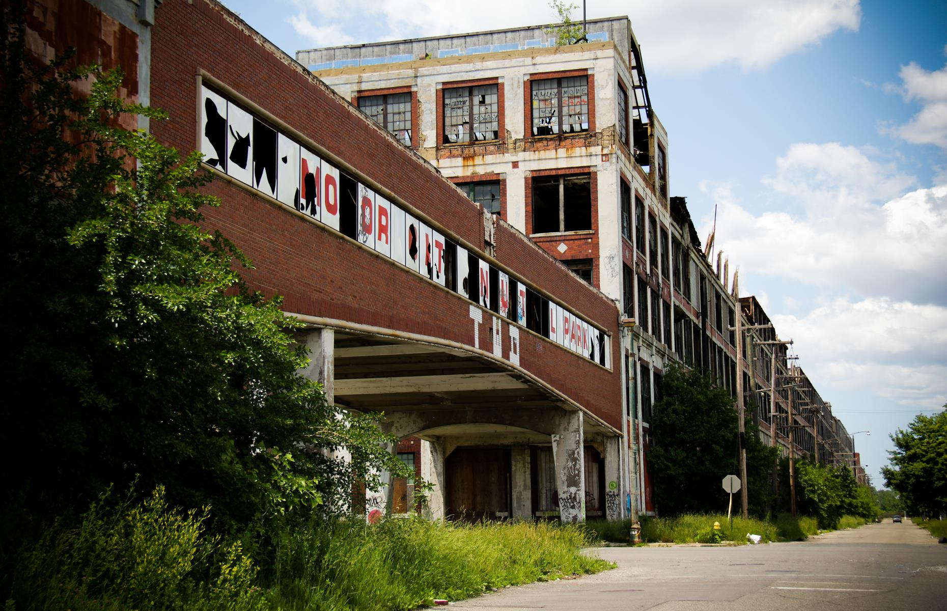 Slide 44 of 101: This huge complex of industrial buildings began life in the early 1900s and served as a headquarters for the Packard Automotive Company. The plant boomed as Detroit gained its reputation as the Motor City – the greatest place for car manufacturing in the States. However, the business struggled after World War II and Packard had folded by 1958.