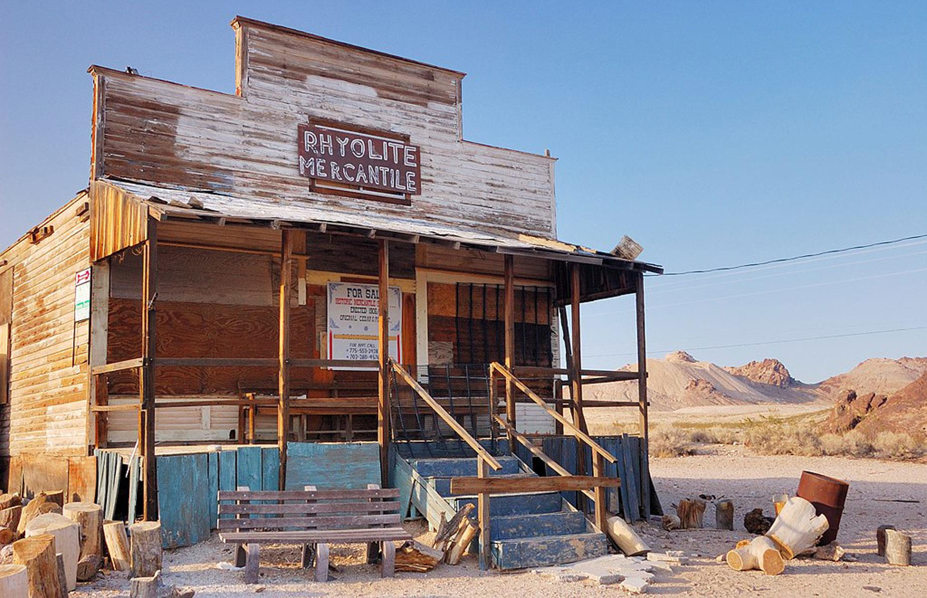 Slide 56 of 101: Nevada isn't short of ghost towns to explore and Rhyolite is one of the largest and most photogenic in the state. The gold mining town was established in 1905 and had amassed a population of 5,000 within a couple of years.