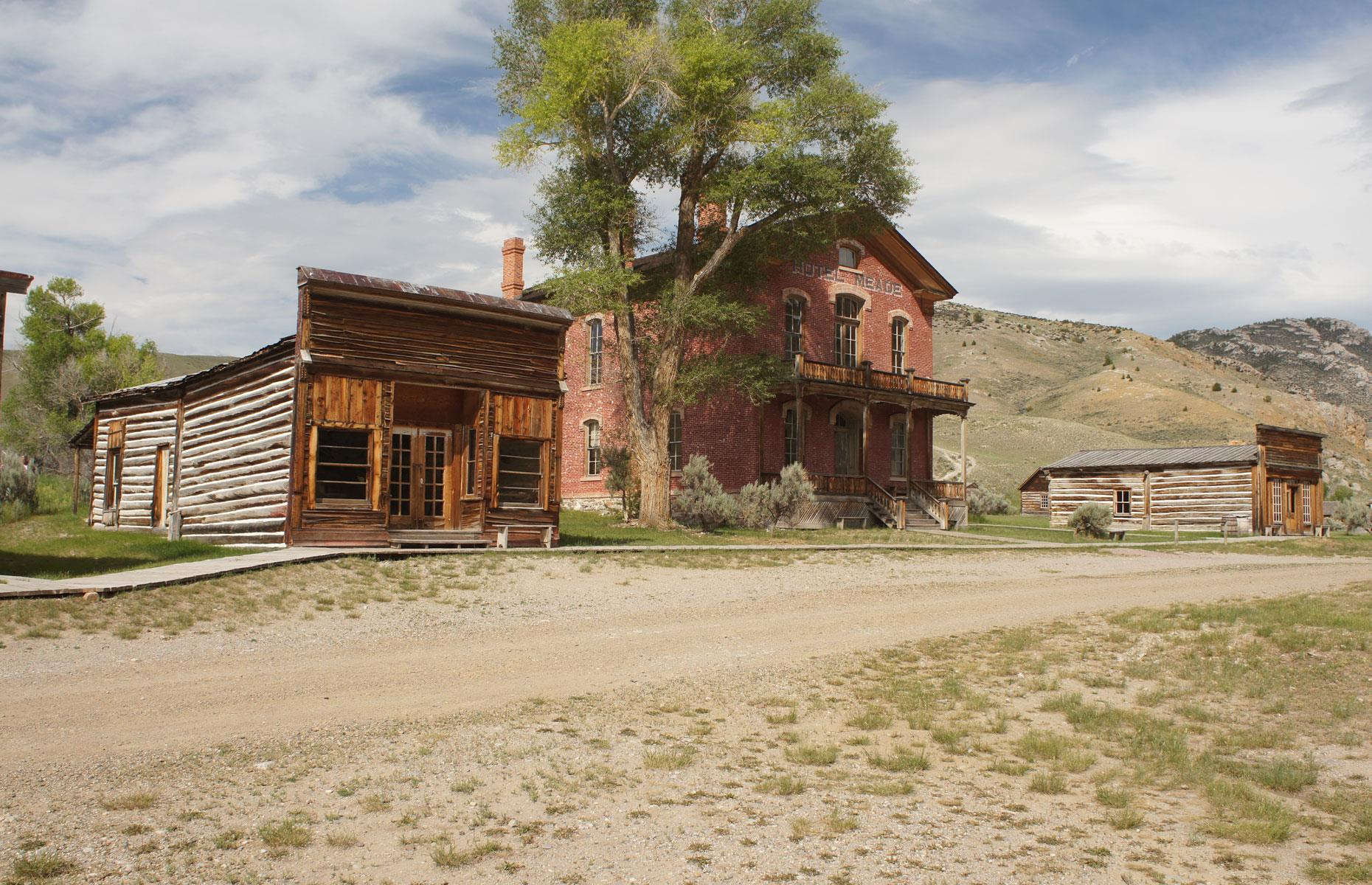Slide 52 of 101: One of America's most emblematic ghost towns, Bannack was founded in 1862. The mining town served as the Montana capital until 1864 and had a population of 10,000 at its peak in the latter half of the 19th century.