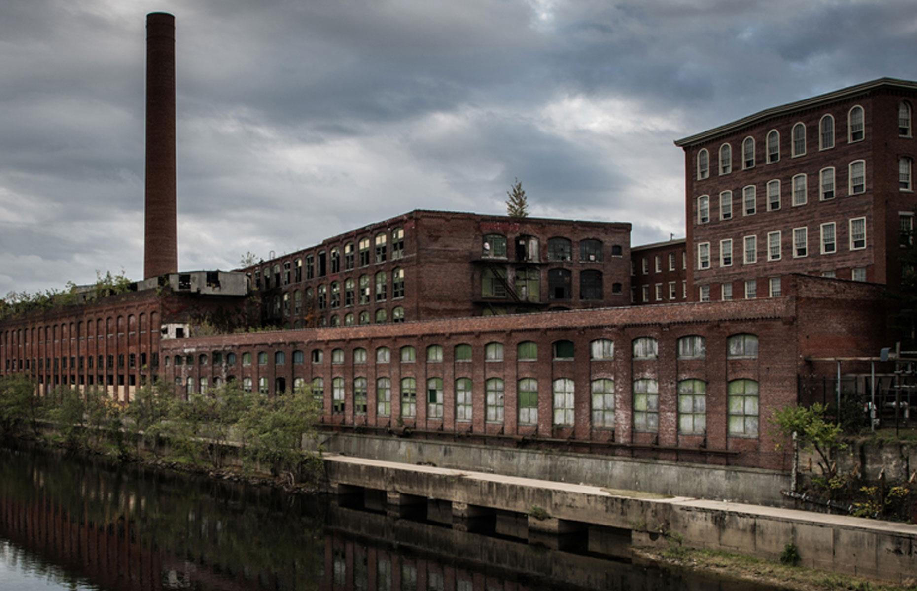 Slide 42 of 101: Famed for its many mills, Lowell is regarded as the birthplace of the Industrial Revolution in America, and was the first real factory town in the US. Founded in the 1820s, it fast became the country's most important center for textile manufacturing.
