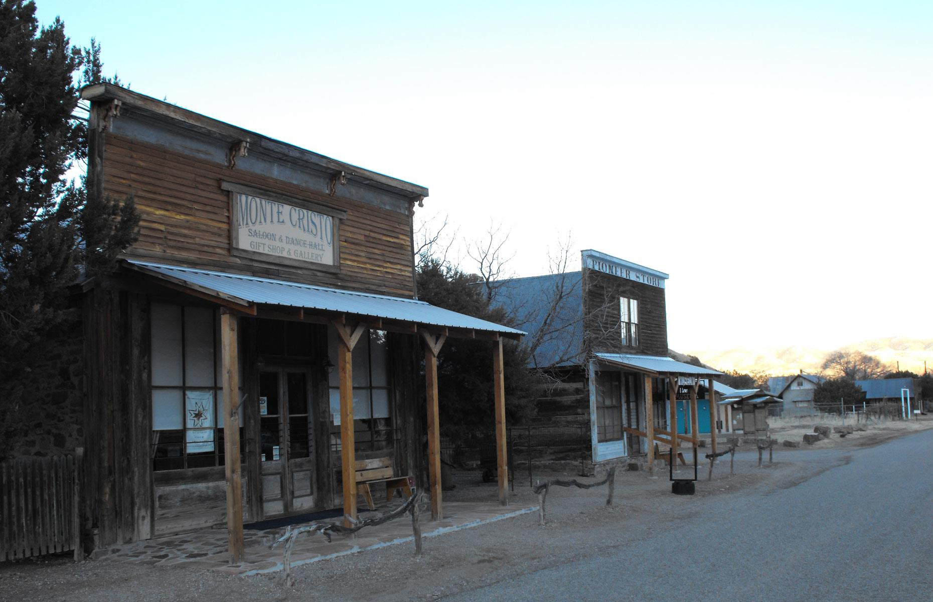 Slide 62 of 101: This semi-ghost town is home to just 11 residents, down from 2,000 at its peak. Chloride was founded in 1880 when silver ore was discovered nearby. Within a few years, the town had everything from a general store to a school, as well as two hotels and a total of nine saloons.