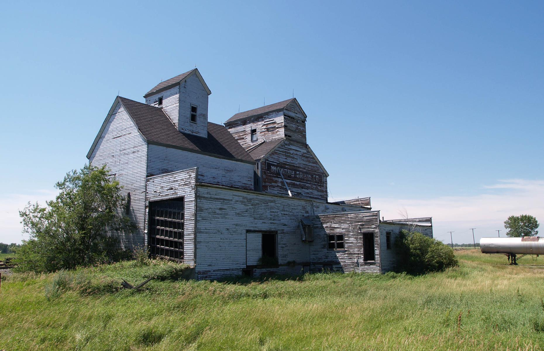 Slide 69 of 101: The remote town was largely abandoned in the mid-20th century when many of the inhabitants left to seek work in larger towns and cities. Today, less than 70 people live in Ardoch, and this grain elevator is one of several abandoned 19th-century buildings. Read about the incredible finds discovered in abandoned barns and buildings