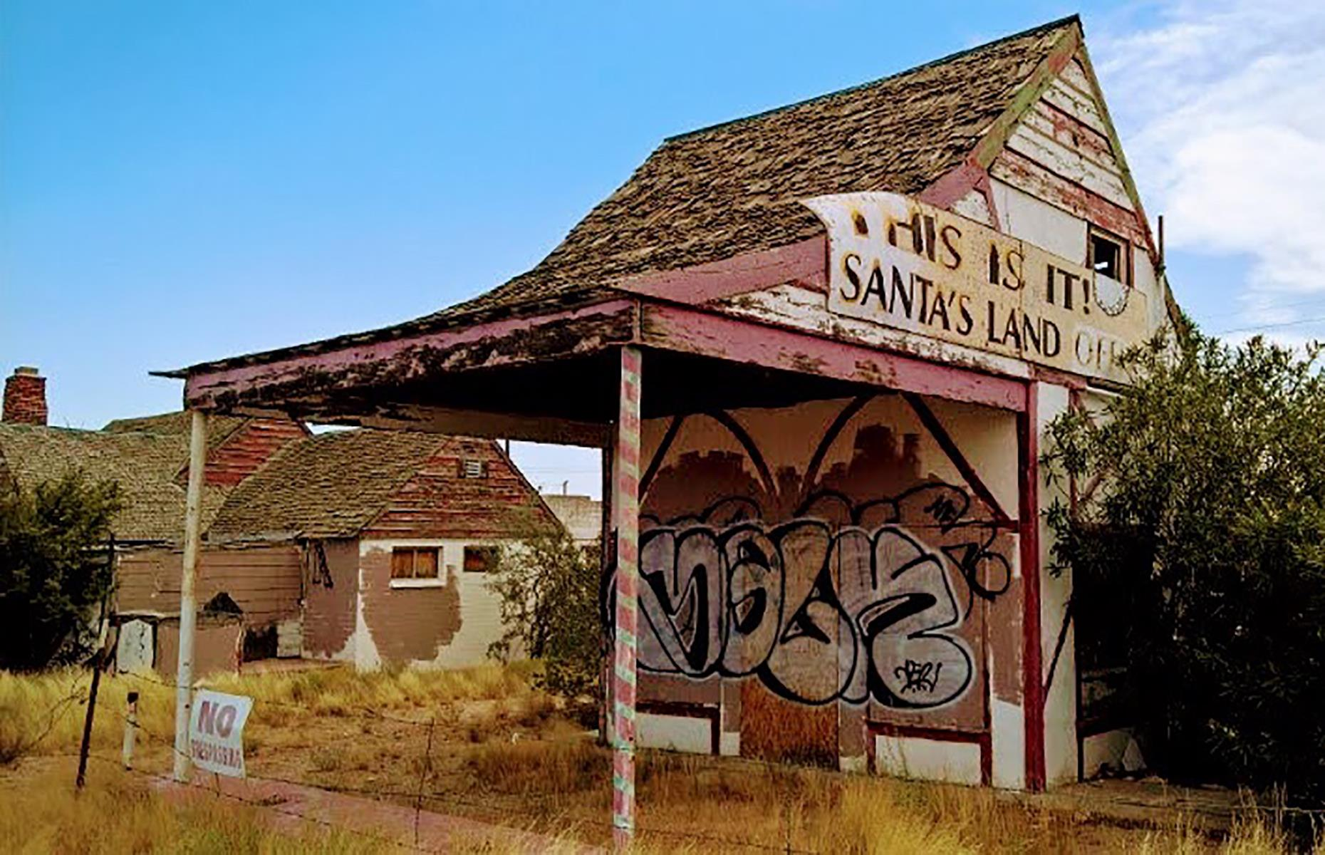 Slide 6 of 101: Just the sort of place you'd expect to find Pennywise, the scary clown in movie It, Santa Claus is a sinister Christmas-themed ghost town in Mohave County. The bizarretown was established in 1937 by realtor Nina Talbot, who hoped to attract buyers to the area.
