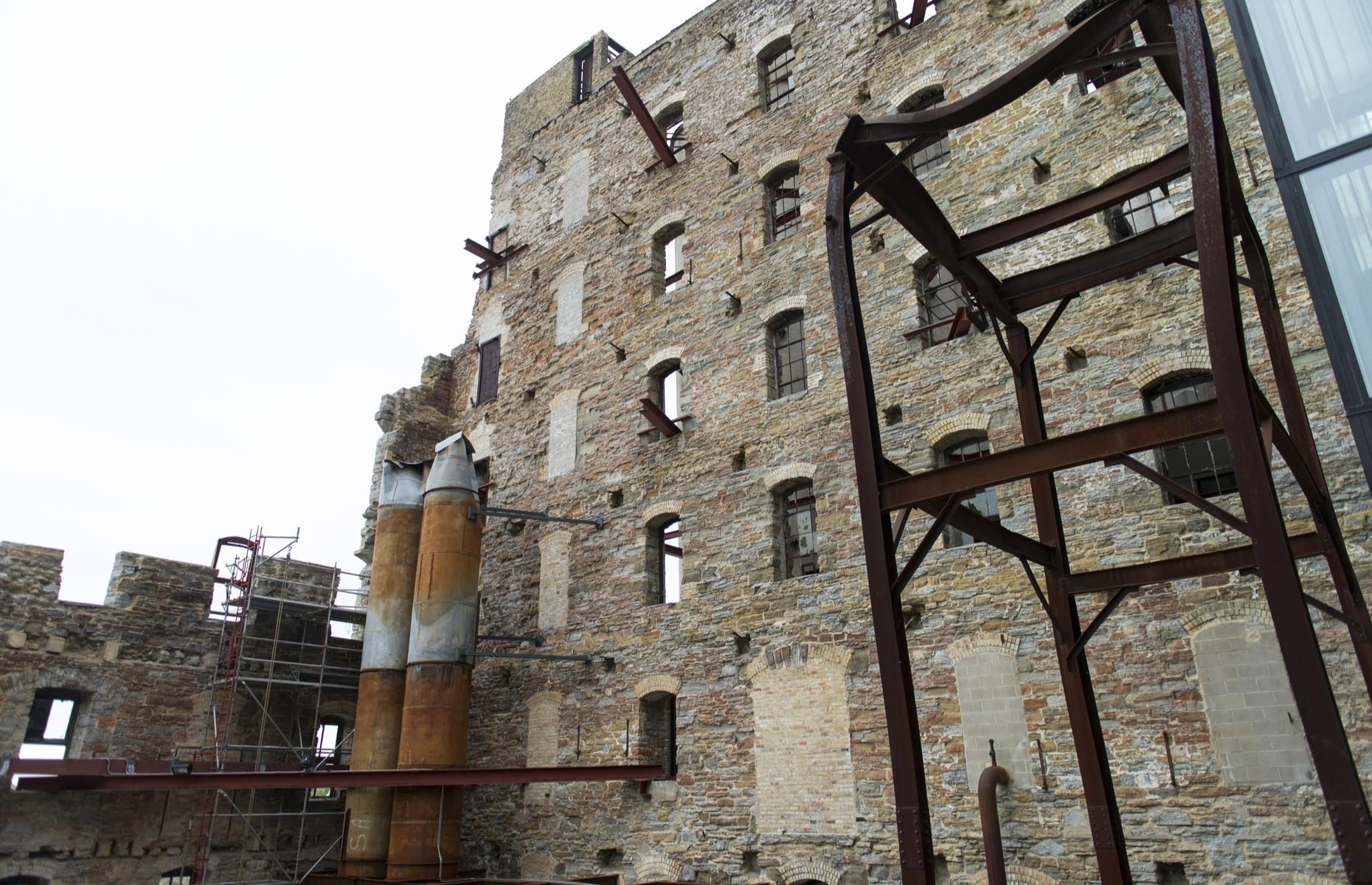 Slide 47 of 101: Later on in the 19th century, the mills eventually closed, but their abandoned remnants remain preserved as part of the Mill Ruins Park. Visitors can walk among the imposing factory walls and put their discoveries into context at the nearby Mill City Museum.