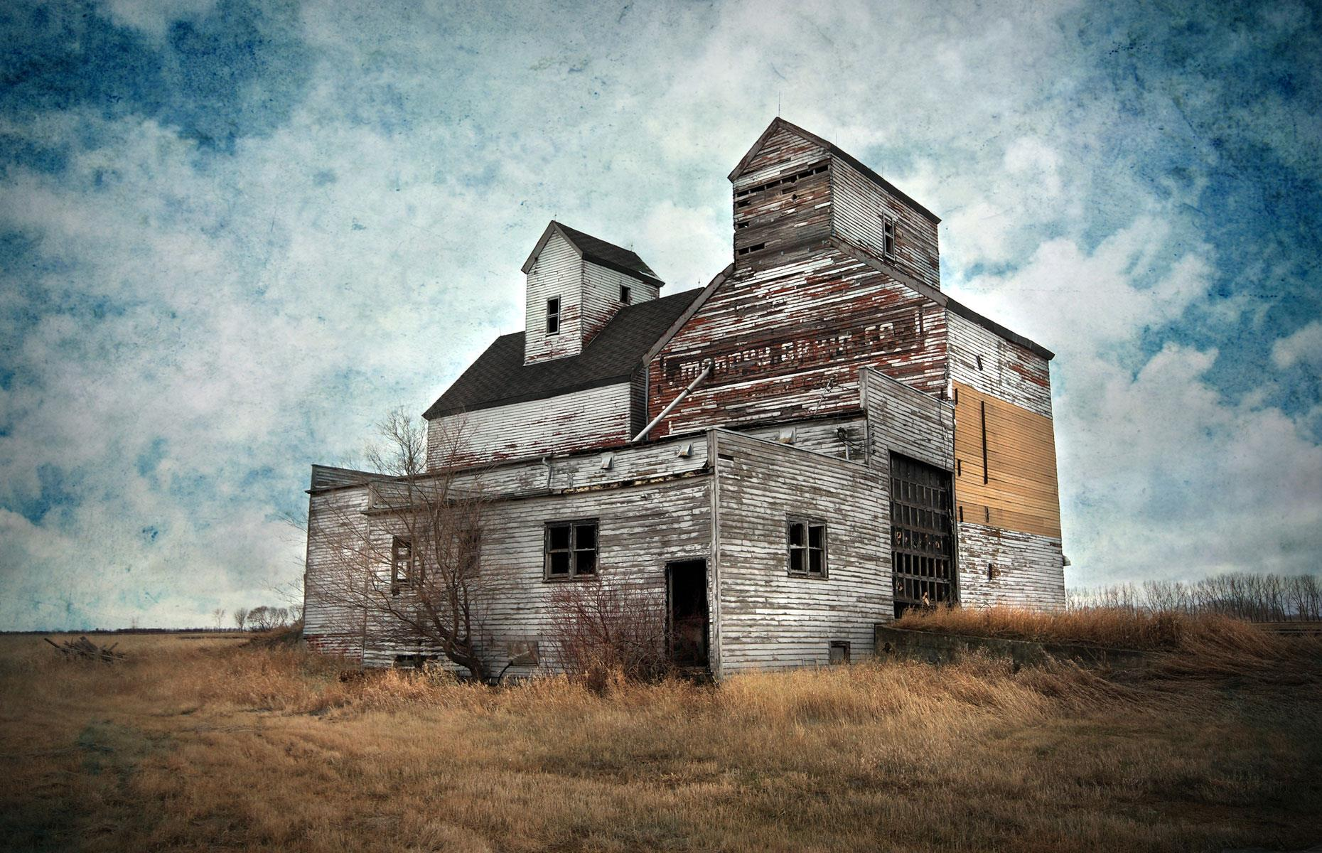 Slide 68 of 101: Located in the semi-abandoned town of Ardoch, the Mondry Grain Elevator was built in 1881 when the town was a thriving center of agriculture.