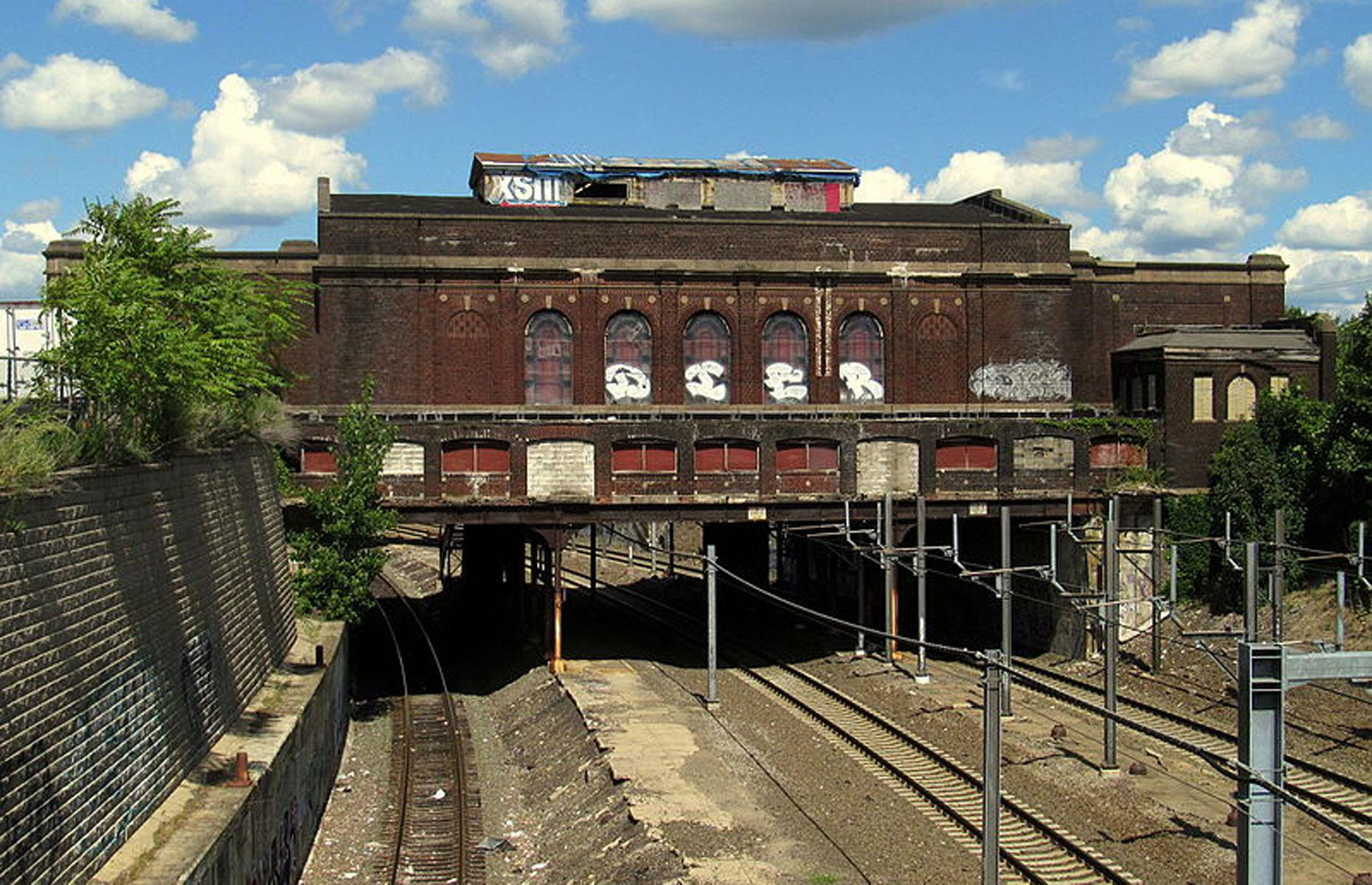 Slide 79 of 101: Though redevelopment plans have been floated over the years, the elegant building currently remains abandoned. Plans to open a brand new station nearby are well underway.