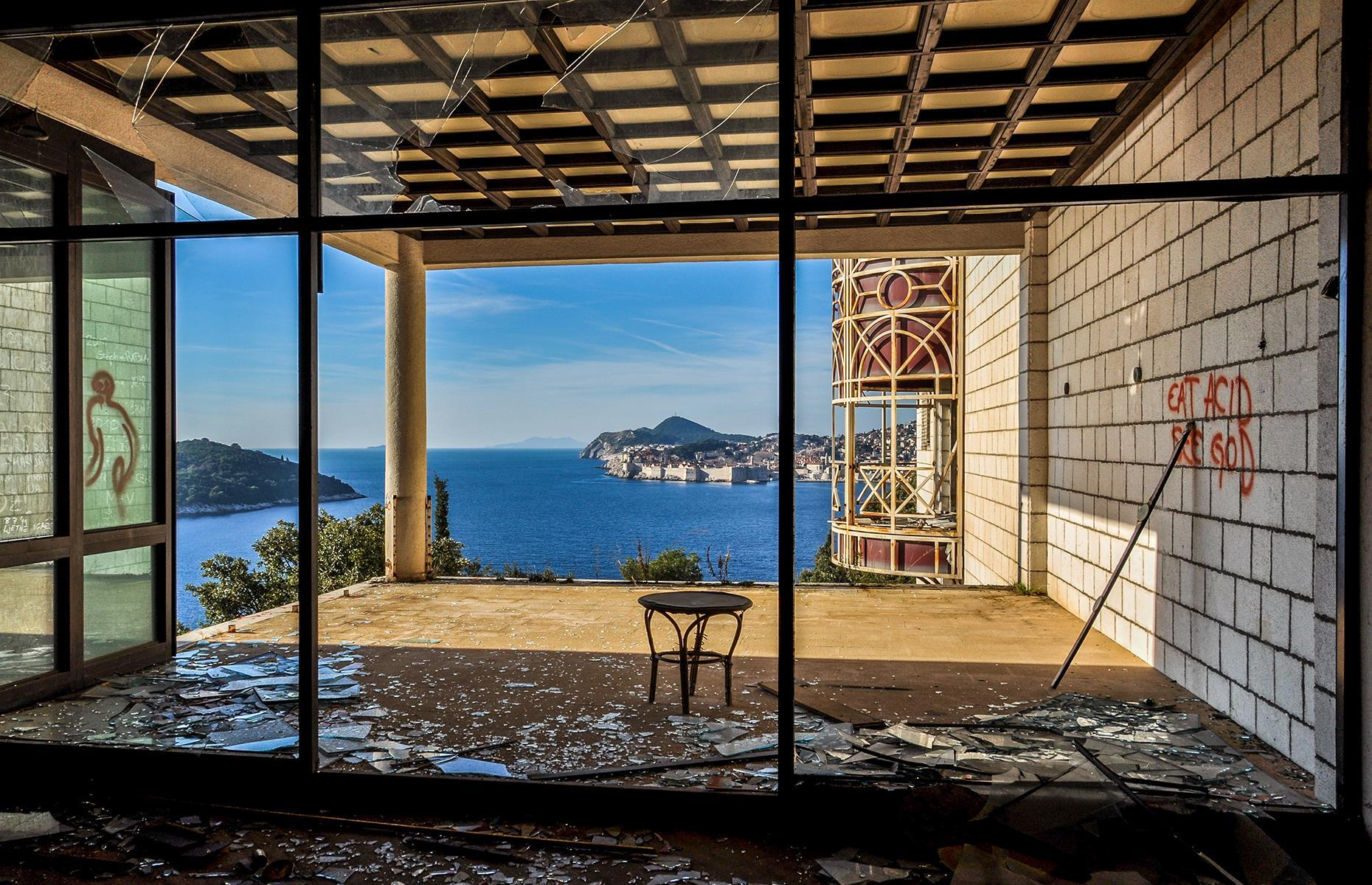 Slide 33 of 70: Located just above the seashore, with views of Dubrovnik and the island of Lokrum, this sprawling resort has fallen victim to vandals. However, part of the hotel was used during the filming of season fourof Game of Thrones. There are plans for the site's demolition and redevelopment.