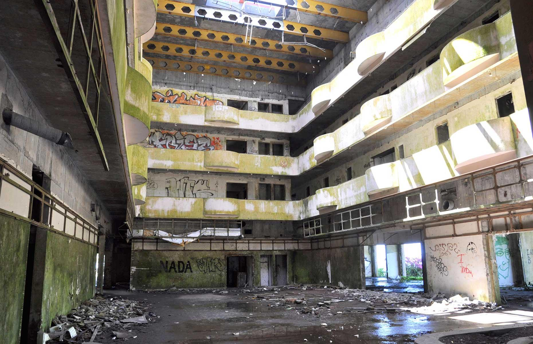 Slide 37 of 70: Opened in 1989 to lure tourists to the then untrammeled Azores, Hotel Monte Palace only operated for just over a year before it was shut. Since then, the mountaintop resort has been abandoned and become a popular destination for urban explorers.