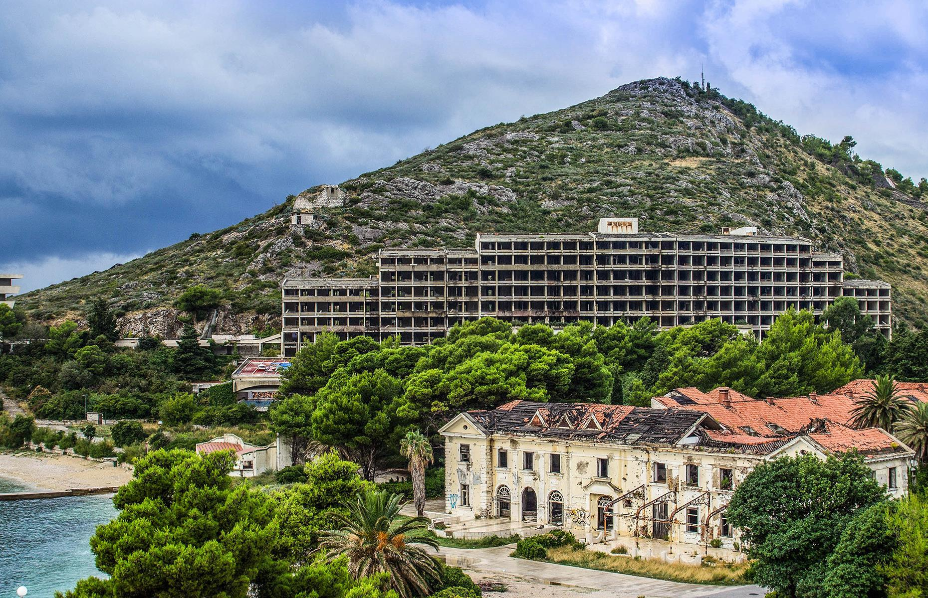 Slide 13 of 70: One of the pioneers of Croatia's tourism, Kupari vacation village was a military resort for the elite of the Yugoslav army from the 1960s. When the Croatian War for Independence broke out in 1991, the army fled, and the resort was heavily bombed.
