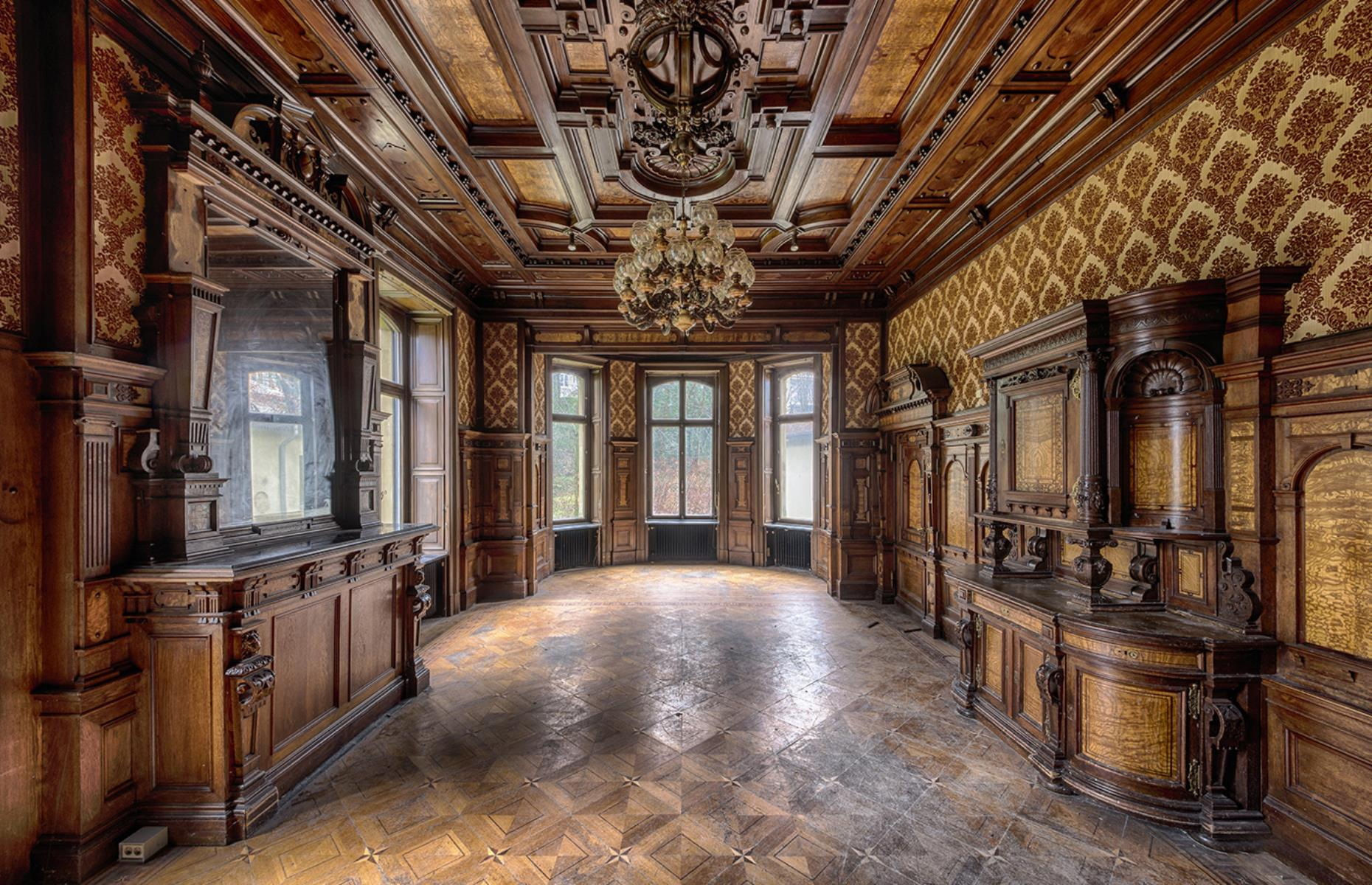 Slide 46 of 70: Also photographed by Brian, this castle in Germany – known as Villa Woodstock thanks to its glorious wooden interior – used to be a hotel and spa built in 1883. From 1990 it was used as a home for the elderly until it closed in 2012 and was left abandoned.