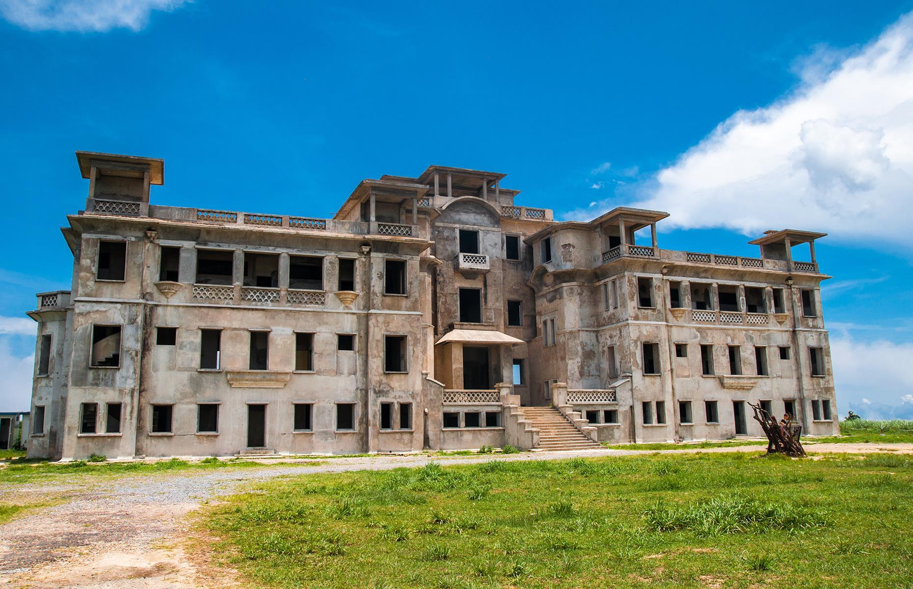 Slide 15 of 70: One of the buildings in the resort known as Bokor Hill Station, the Bokor Palace was built as a mountain retreat for Europeans in the early 1920s, when Cambodia was under French rule.